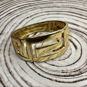Hinged gold cuff bracelet